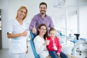 Happy family visiting their Rowley dentist together
