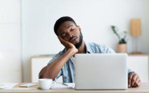 Man with sleep apnea napping at his desk